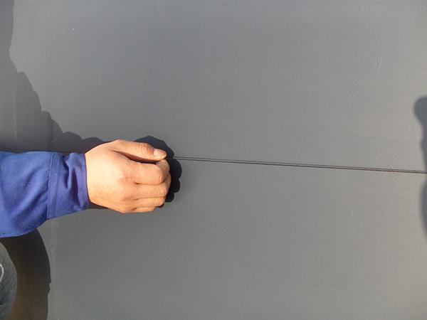 外墙仿石灰石涂料弹线分格施工