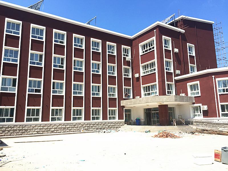 海淀小学外墙天然真石漆施工