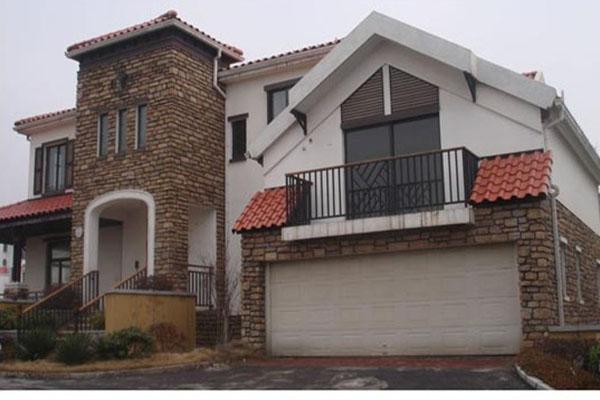 别墅改造翻新外墙真石漆