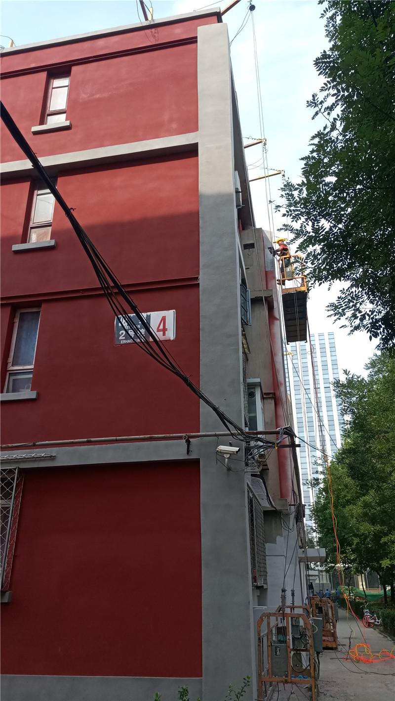 北京旧楼改造翻新喷涂外墙天然真石漆罩光漆