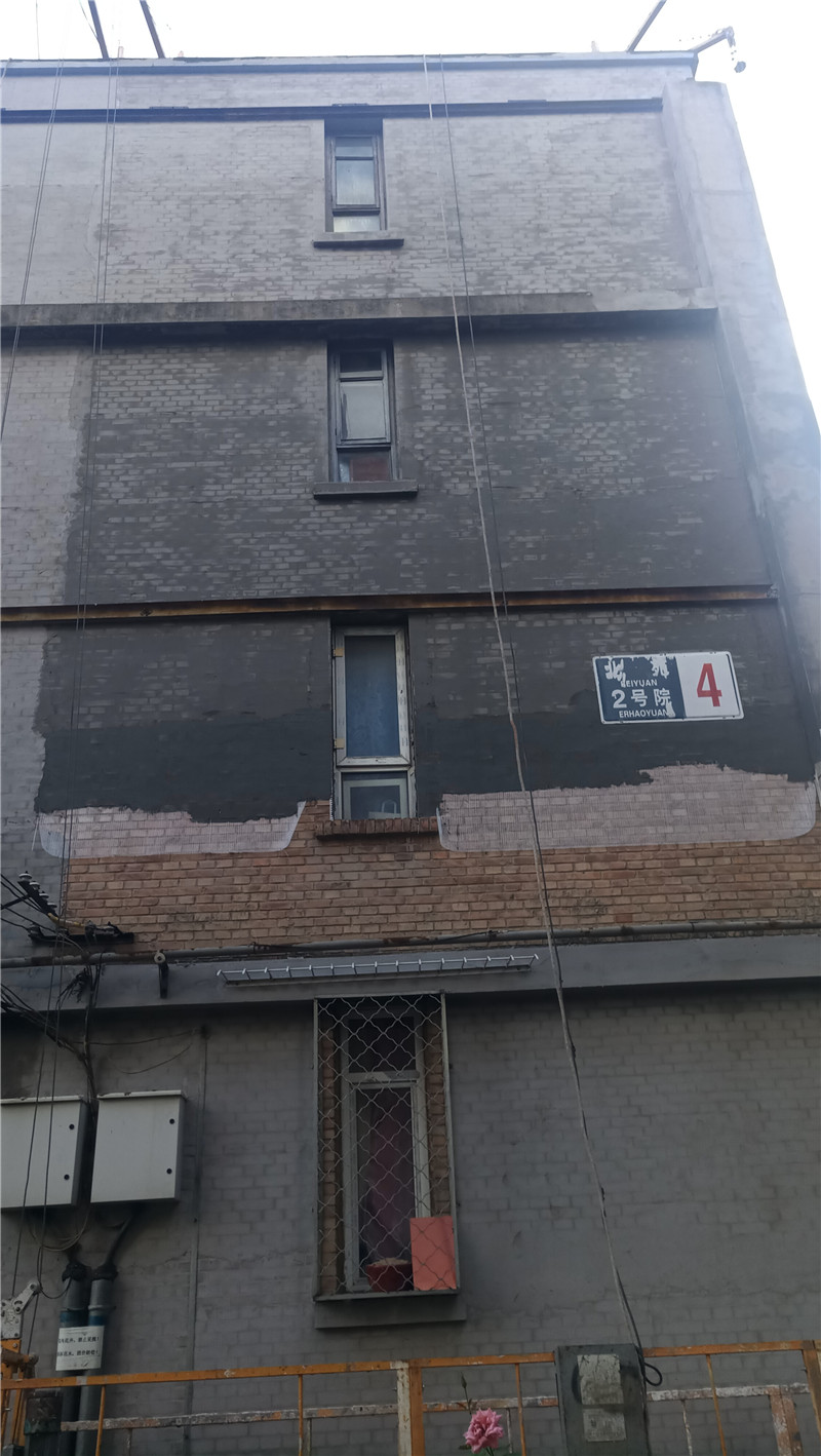 旧楼外墙翻新改造挂网抹灰